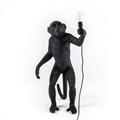 Seletti Торшер Обезьяна стоит с лампочкой в руках